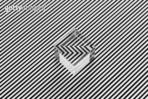 Black and White Parallel Stripes Illusion Disordered by a Cube Prism, High Angle View. - gettyimageskorea