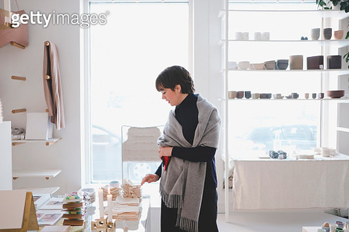 Young female customer examining swatches in store - gettyimageskorea