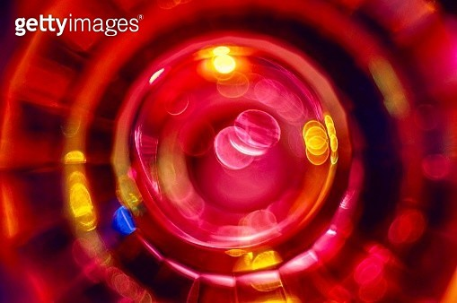 Glowing red concentric rings of light against black background - gettyimageskorea