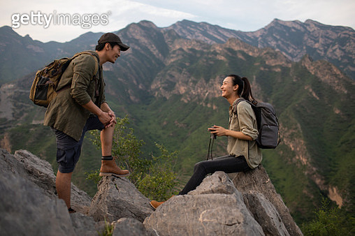 Young couple hiking outdoors - gettyimageskorea