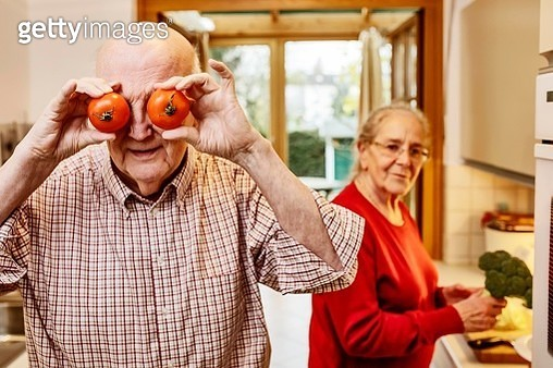Senior is cooking tomatoes with his woman, Germany - gettyimageskorea