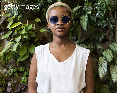 Portrait of confident young woman with bleached hair - gettyimageskorea