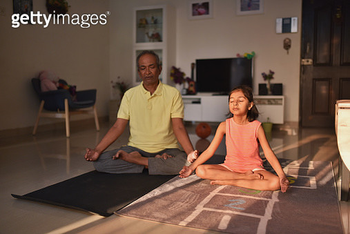 Grandfather and granddaughter doing Yoga - gettyimageskorea