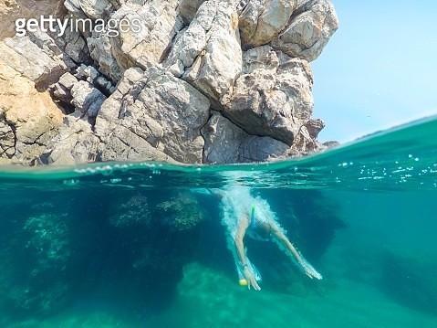 Man diving into water in Ionian Sea, Greece - gettyimageskorea