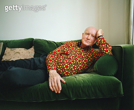 Portrait of a senior man relaxing at home on the sofa - gettyimageskorea