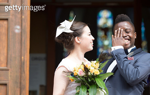 Woman and man are smiling at their marriage ceremony. - gettyimageskorea