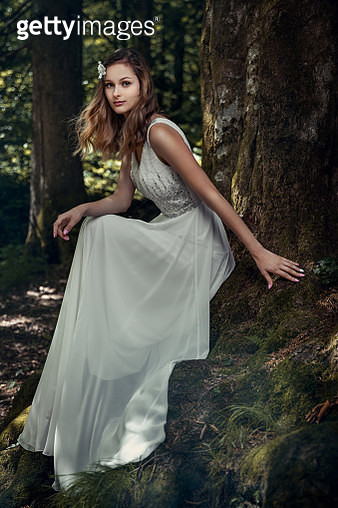 Beautiful bride with wedding makeup and long curly hair. Bridal fashion model with posing outdoors. - gettyimageskorea