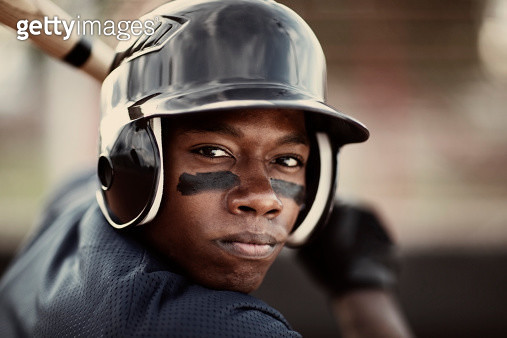 Close up of an African American baseball player who is ready to mash the ball. - gettyimageskorea