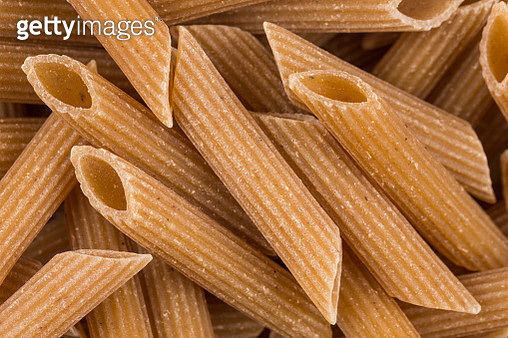 Wholemeal Pasta Penne as close-up shot for background - gettyimageskorea