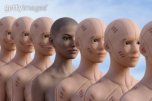 Woman standing in row of robots - gettyimageskorea