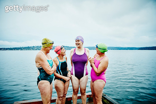 Laughing swimmers preparing for morning swim - gettyimageskorea