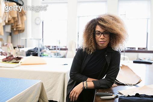 Portrait confident female fashion designer in studio - gettyimageskorea