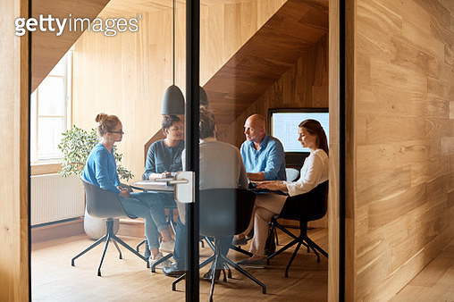 Business people discussing in meeting at office - gettyimageskorea