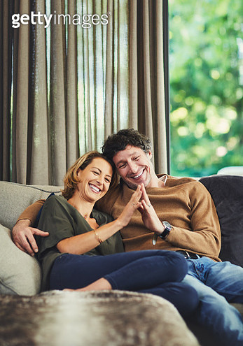 Shot of an affectionate mature couple relaxing on the sofa at home - gettyimageskorea