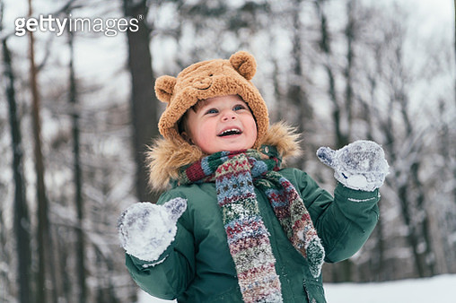 Excited child in winter forest - gettyimageskorea