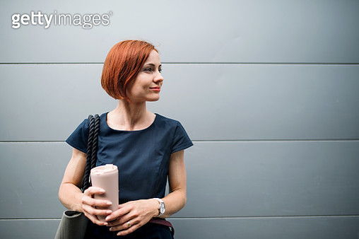 A woman commuter with dress in summer. Copy space. - gettyimageskorea