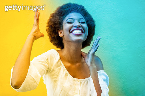 Portrait Of Smiling Young Woman Against Wall - gettyimageskorea