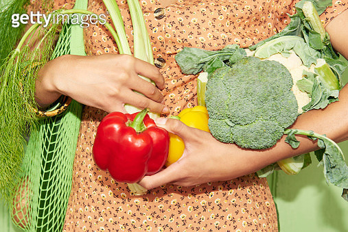 Close up of woman holding vegetables - gettyimageskorea