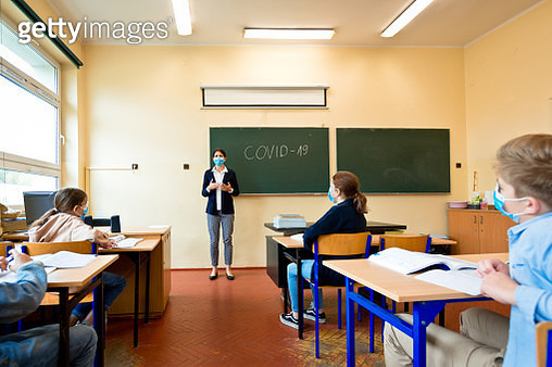 Covid-19. A teacher explains epidemic prevention knowledge at a school - gettyimageskorea