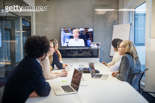 Group of business people having video conference in boardroom. Diverse business professionals having video conference meeting in office. - gettyimageskorea