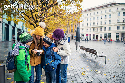 Mother with three kids sightseeing city of Brno. Family is checking photos on the camera on the main town square.Nikon D850 - gettyimageskorea
