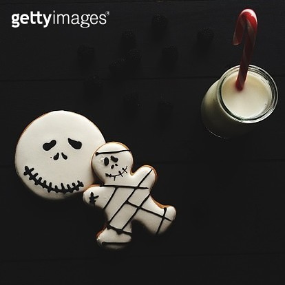 Close Up Of Halloween Cookies With Milk On Black Background - gettyimageskorea