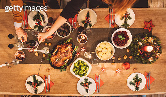 Overhead view of friends prepare table for christmas party - gettyimageskorea
