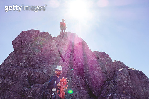 Low Angle View Of Male Hikers Hiking On Mountain Against Clear Sky - gettyimageskorea