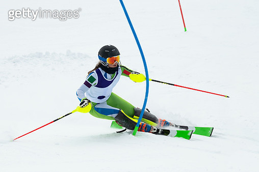 Young Women at Slalom Skiing Passing the Blue Gate - gettyimageskorea