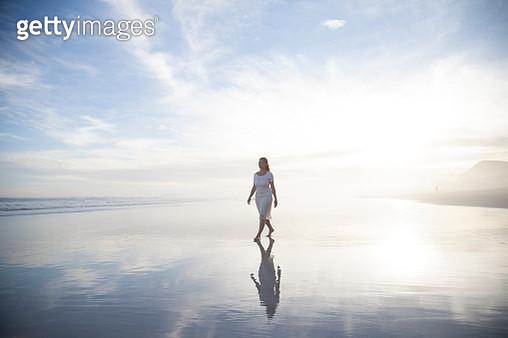 Woman walking on beach - gettyimageskorea