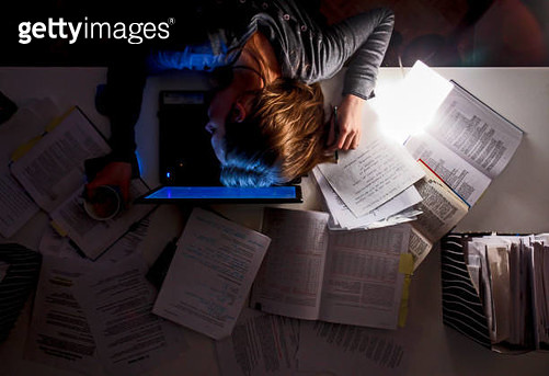 Tired, working woman sleeping on laptop late at night. - gettyimageskorea