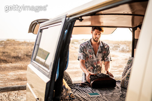 Handsome man traveling in a van. - gettyimageskorea