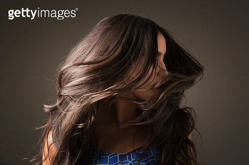 Mixed Race woman tossing hair - gettyimageskorea