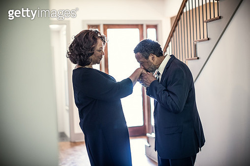Senior couple embracing in hallway of their home - gettyimageskorea