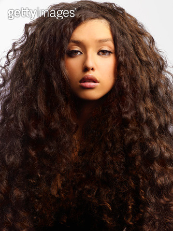 Mixed race woman with thick curly hair - gettyimageskorea