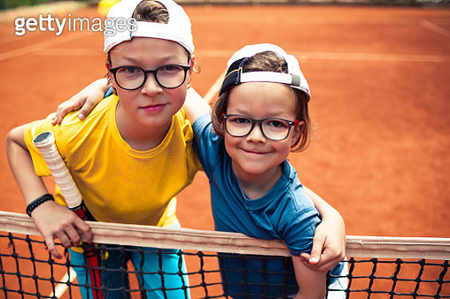 Brothers playing tennis - gettyimageskorea