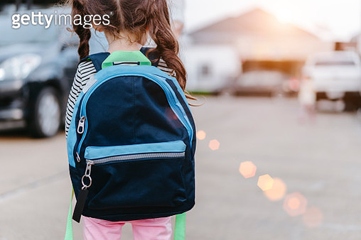 Rear View Of Girl With Backpack On Street - gettyimageskorea