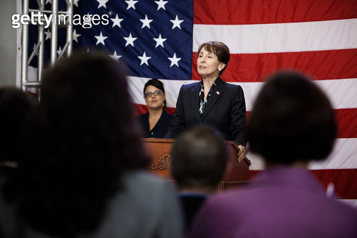 Female politician making speech at podium - gettyimageskorea