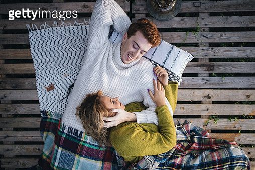 Gorgeous couple relaxing outdoors in love - gettyimageskorea