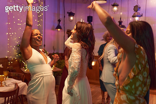 Lesbian wedding and friends having dinner party - gettyimageskorea