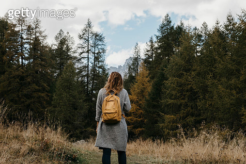 Switzerland, Engadin, woman on a hiking trip in forest - gettyimageskorea