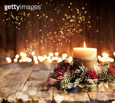 Christmas holiday elegant candle set against Christmas lights and old textured and toned wood background - gettyimageskorea
