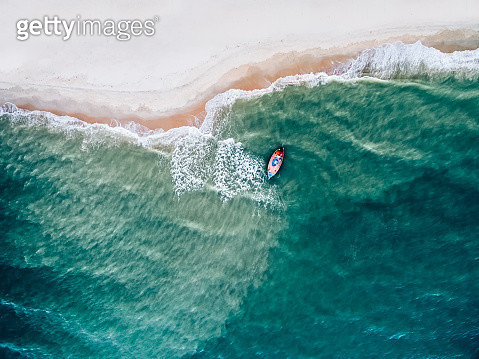Top view of a fishing boat at the beach - gettyimageskorea