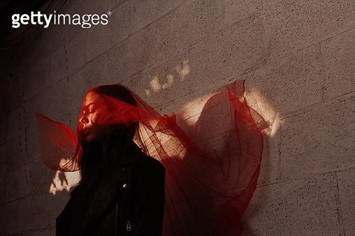 Close-Up Of Woman With Scarf Standing Against Wall - gettyimageskorea