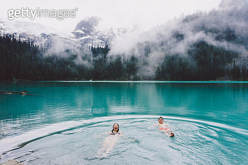 Friends Swimming In Lake During Foggy Weather - gettyimageskorea