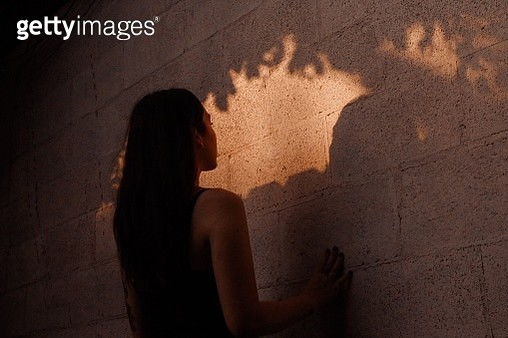 Close-Up Of Woman Standing Against Wall - gettyimageskorea
