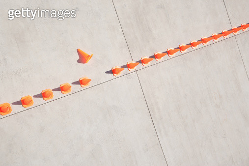 Row of traffic cones with one on side - gettyimageskorea