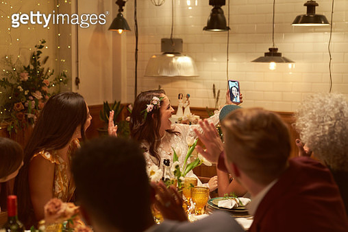 Lesbian wedding party with a friend on a video call - gettyimageskorea