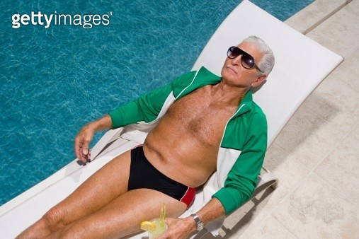Senior man relaxing by pool - gettyimageskorea