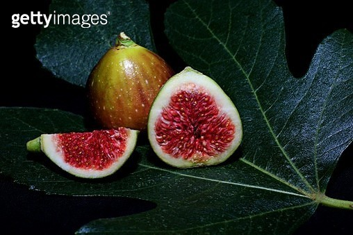 Close-Up Of Fig Against Black Background - gettyimageskorea